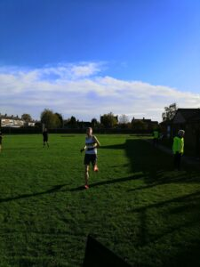Alex Mitton racing to the finish line of the 10K race
